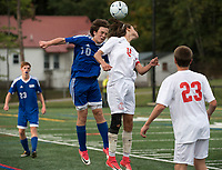 Gilford's Nate Hudson and Laconia's Thomas Turpin go up for a head ball during NHIAA Division III soccer on Thursday afternoon.  (Karen Bobotas/for the Laconia Daily Sun)