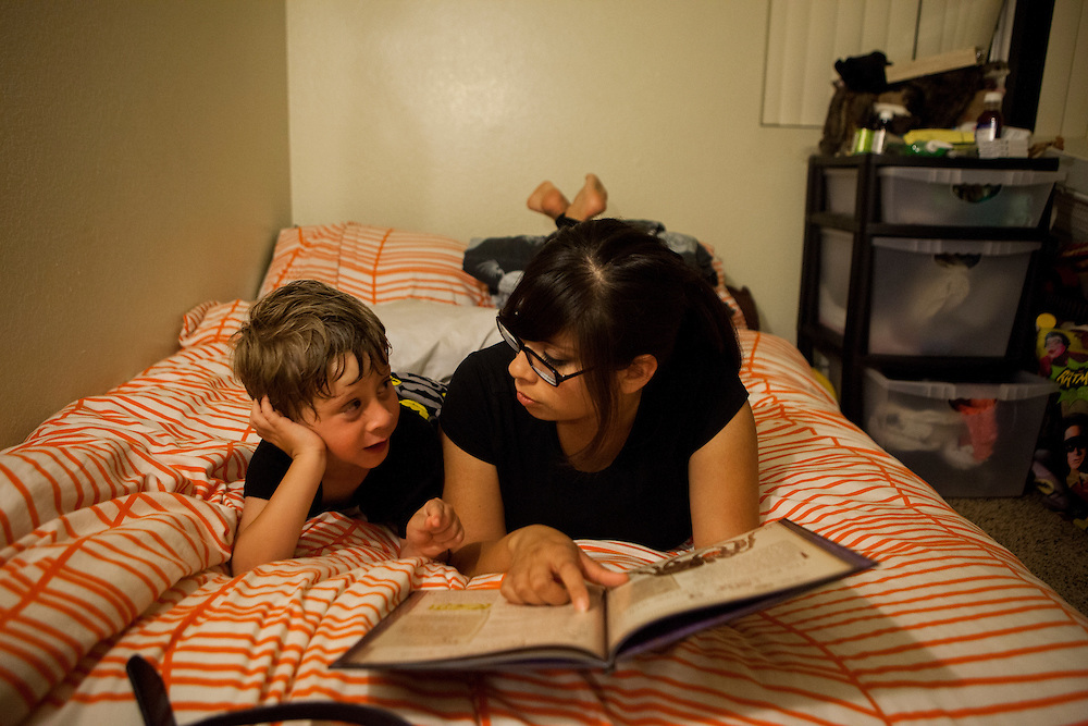 SAN DIEGO, CA - JULY 8, 2014:  Jannette Navarro, 22, reads to her son Gavin before tucking him into bed. CREDIT: Sam Hodgson for The New York Times