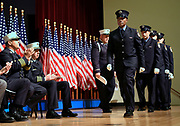 Aleigha D. Powder walks the stage to receive her graduation plaque during the FDNY firefighter graduation at Queens College on Friday, Nov. 6, 2015 in Flushing, N.Y. Powder was one of four women to graduate.