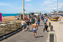 © Licensed to London News Pictures. 12/07/2020. Brighton, UK. Members of the public take to the beach in Brighton And Hove as sunny and warm weather is hitting the seaside resort. Photo credit: Hugo Michiels/LNP