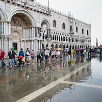 VENICE, ITALY - JUNE 07:   Unusual summer flooding of St Mark's Square due to high tid and heavy rains on June 7, 2011 in Venice, Italy. Thunderstorms and heavy rain have hit Venice causing an out season high tide of 90 cm flooding St Mark's square.