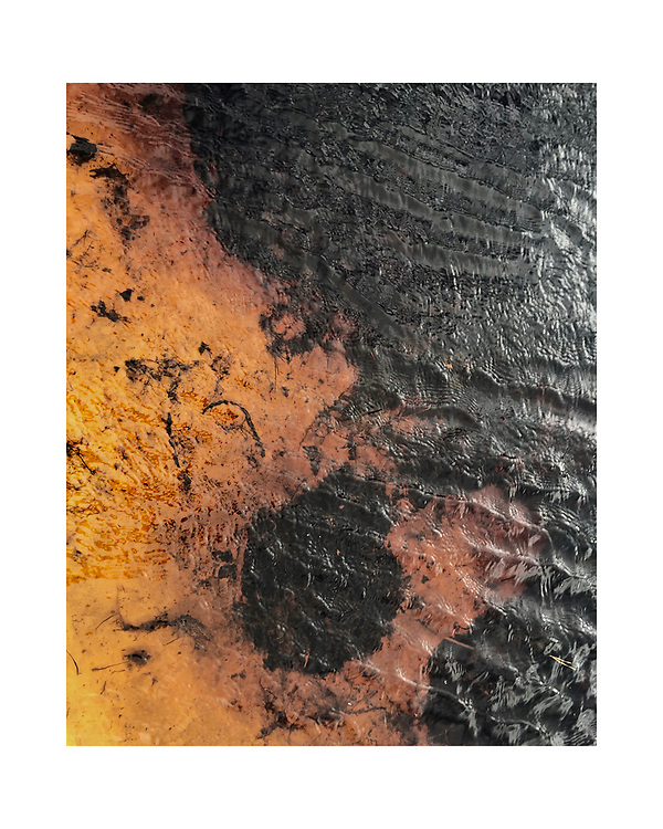 The vibrant color of cedar water, soil and light reflecting off of waves create an abstract image, much like a painting.