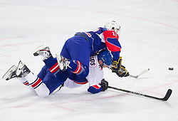 Rok Pajic of Slovenia vs Colin Shields of Great Britain during ice-hockey match between Great Britain and Slovenia at IIHF World Championship DIV. I Group A Slovenia 2012, on April 15, 2012 in Arena Stozice, Ljubljana, Slovenia. (Photo by Vid Ponikvar / Sportida.com)