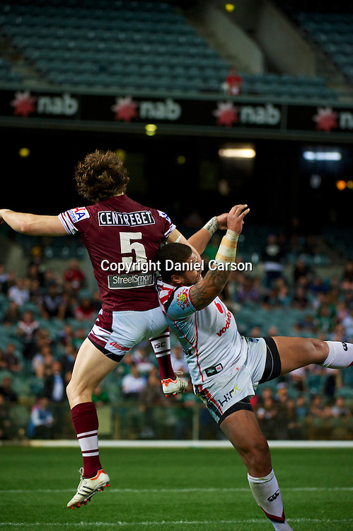 David Williams of the Sea Eagles knocks a high ball away during the NRL Rugby League match, Vodafone Warriors v Manly Sea Eagles at Patersons Stadium, Perth, Australia on Saturday 28 July 2012. Photo: Daniel Carson/photosport.co.nz