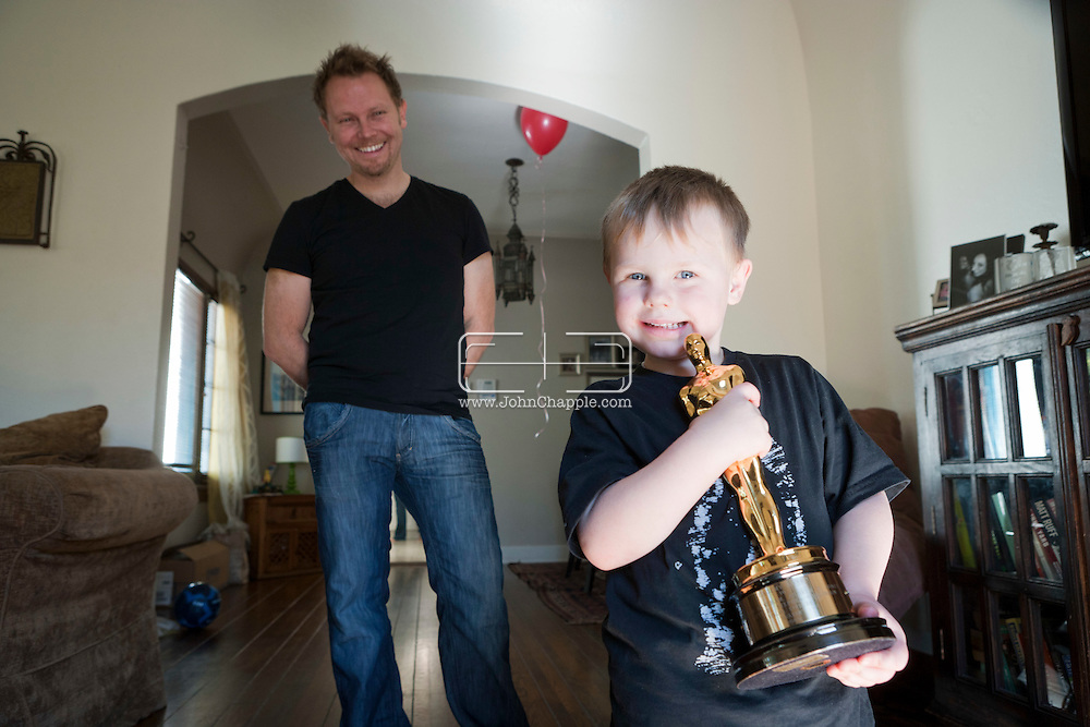 11th February 2011. Glendale, California.  Dubliner Richie Baneham, won the Oscar for Best Visual Effects in 2010 for his work on the groundbreaking 3D science fiction film Avatar. Richie's 3-year-old son Nathan holds his Dad's Oscar..Photo © John Chapple / www.johnchapple.com..