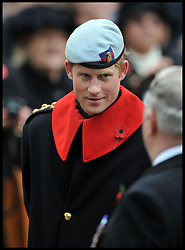 In the frame - Prince Harry.<br /> The Duke of Edinburgh accompanied by Prince Harry during their visit to the Field of Remembrance. Westminster Abbey, London, United Kingdom. Thursday, 7th November 2013. Picture by Andrew Parsons / i-Images
