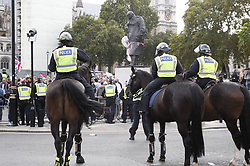© Licensed to London News Pictures. 07/09/2019. London, UK. Police surround right wing protestors in Parliament Square after clashes with Pro EU demonstrators in central London. Photo credit: Peter Macdiarmid/LNP