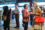 Josephine Hanan of PHB (left) and Ekaterina Rekhovskaya of Flagship network during the Silicon Valley Business Journal's HHaaS Tech Mixer at ZERO1 in San Jose, California, on May 28, 2015. (Stan Olszewski/SOSKIphoto for the Silicon Valley Business Journal)