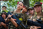 Youngsters participating to the ultra-nationalistic Azovets children's camp are listening attentively to their laser-gun instructor, on the banks of the Dnieper river in Kiev, Ukraine's capital.