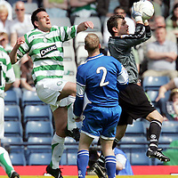 St Johnstone v Celtic...Scottish Cup Semi-Final...14.04.07<br /> Kevin Cuthbert gets the ball ahead of Jan Vennegoor of Hesselink<br /> <br /> Picture by Graeme Hart.<br /> Copyright Perthshire Picture Agency<br /> Tel: 01738 623350  Mobile: 07990 594431