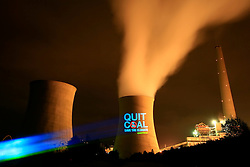"SPAIN GALICIA AS PONTES 1OCT08 - A Coruña, Spain, 1 October 2008 – Greenpeace activists projected ""Quit Coal,.Save the Climate"" in Spanish and in English, onto the cooling towers of the As Ponters coal fired power plant in A Coruña, which consumes 20% of Spanish coal and is one of the most polluting power plants in Europe. The protest comes a week before the European Parliament votes on the EU's climate.package, and the construction of over 50 coal plants in Europe...Greenpeace demands the EU votes for measures to block the construction of coal plants, and cut greenhouse gas emissions by at least 30% by 2020. The protest is part of a 4 month ""quit coal"" ship tour from Israel to Poland, in the run-up to crucial climate negotiations in Poznan, Poland this December...jre/Photo by Jiri Rezac / GREENPEACE..© Jiri Rezac 2008..Contact: +44 (0) 7050 110 417.Mobile:  +44 (0) 7801 337 683.Office:  +44 (0) 20 8968 9635..Email:   jiri@jirirezac.com.Web:    www.jirirezac.com..All images © Jiri Rezac 2008. All rights reserved."