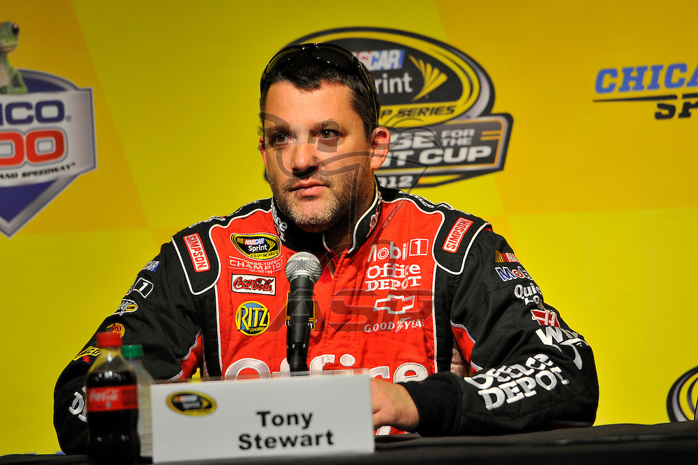 Joliet, IL - SEP 14, 2012: Tony Stewart (14) talks during a press conference during practice for the Geico 400 at the Chicagoland Speedway in Joliet, IL.