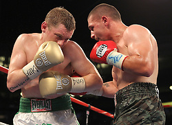 June 5, 2010; Bronx, NY; USA;  Pawel Wolak (Camo trunks) and James Moore (white trunks) trade punches during their bout at Yankee Stadium.  Wolak won via unanimous decision.