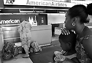 Amber and Marcus anxiously wait for their father Johnny McDaniel at Newark Liberty Airport. McDaniel missed his connecting flight and his family waited all day for his arrival.