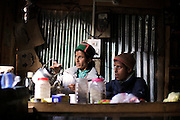 A Kinnauri Lady making tea in Chitkul Village in Baspa Valley in Kinnaur, Himachal Pradesh. <br /> <br /> Chitkul is a small village with a population of only 610 people. It is the last village on the Old Hindustan Tibet Road. The village is also known as the last village of India.