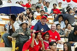BANGKOK, THAILAND - Wednesday, July 23, 2003: Two Scouse Liverpool fans mingle with the local Thai fans to watch the team training at the Rajamangala National Stadium. (Pic by David Rawcliffe/Propaganda)