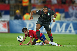 NOVI SAD, SERBIA - Tuesday, September 11, 2012: Wales' Ashley Williams in action against Serbia's Zoran Tosic during the 2014 FIFA World Cup Brazil Qualifying Group A match at the Karadorde Stadium. (Pic by David Rawcliffe/Propaganda)