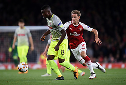FC Koln's Jhon Cordoba (left) and Arsenal's Nacho Monreal (right) battle for the ball