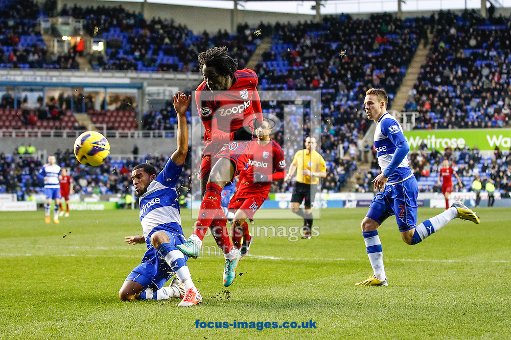 Picture by Andrew Tobin/Focus Images Ltd +44 7710 761829.12/01/2013.Romelu Lukaku of West Brom has a shot blocked by Adrian Mariappa of Reading during the Barclays Premier League match at the Madejski Stadium, Reading.