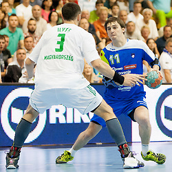 Ferenc Ilyes #3 of Hungary and Sebastian Skube #11 of Slovenia during handball match between National teams of Slovenia and Hungary in play off of 2015 Men's World Championship Qualifications on June 15, 2014 in Rdeca dvorana, Velenje, Slovenia. Photo by Urban Urbanc / Sportida