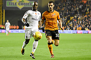 Wolverhampton Wanderers striker Leo Bonatini (33) battles with Fulham midfielder Neeskens Kebano (7) 2-0 during the EFL Sky Bet Championship match between Wolverhampton Wanderers and Fulham at Molineux, Wolverhampton, England on 3 November 2017. Photo by Alan Franklin.