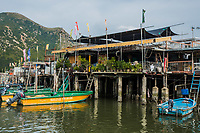 Tai O, Hong Kong, China- June 10, 2014: stilt houses and fishermen motorboats in Lantau island