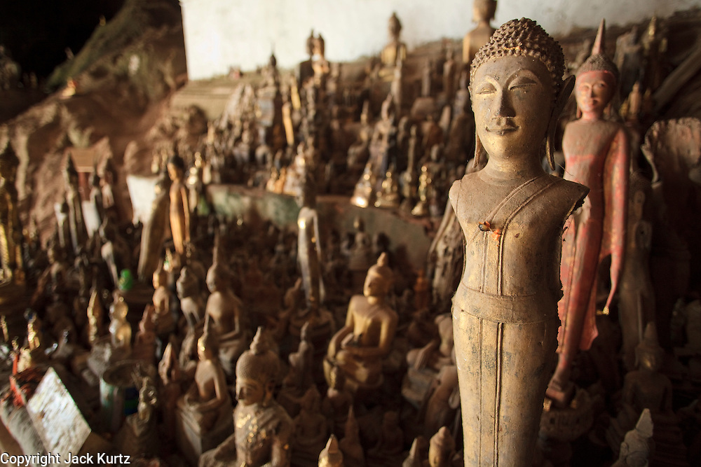 Mar. 14, 2009 -- LUANG PRABANG, LAOS: Statues of Buddha in a Buddhist shrine in the Pak Ou caves near Luang Prabang. The caves house thousands of Buddha statues and is one of the most important Buddhist sites in Laos. Photo by Jack Kurtz / ZUMA Press