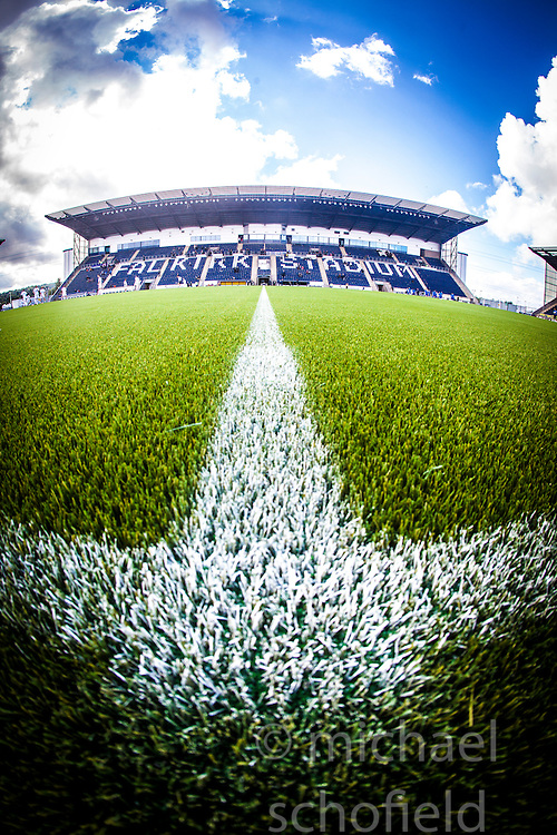 An upright image of the Main Stand. The Falkirk Stadium, with the new pitch work for the Scottish Championship game v Morton. The woven GreenFields MX synthetic turf and the surface has been specifically designed for football with 50mm tufts compared with the longer 65mm which has been used for mixed football and rugby uses.  It is fully FFA two star compliant and conforms to rules laid out by the SPL and SFL.<br />