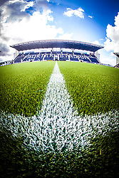 An upright image of the Main Stand. The Falkirk Stadium, with the new pitch work for the Scottish Championship game v Morton. The woven GreenFields MX synthetic turf and the surface has been specifically designed for football with 50mm tufts compared with the longer 65mm which has been used for mixed football and rugby uses.  It is fully FFA two star compliant and conforms to rules laid out by the SPL and SFL.<br /> &copy;Michael Schofield.