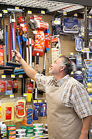 Mature salesperson working in hardware store