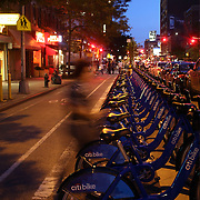 A Citi Bike docking station at night time in Manhattan, New York. Citi Bike the NYC Bicycle Share Program sponsored by Citi Bank, launched in late May 2013 giving access to thousands of bikes at docking stations throughout  Manhattan and parts of Brooklyn. Manhattan, New York, USA. 4th June 2013. Photo Tim Clayton