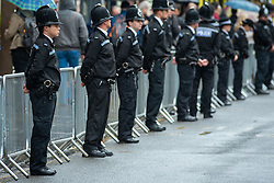© Licensed to London News Pictures. 14/10/2019. Oxford, UK. Thames Valley Police officer's line the road in Oxford city centre ahead of the funeral of PC Andrew Harper. Photo credit: Peter Manning/LNP