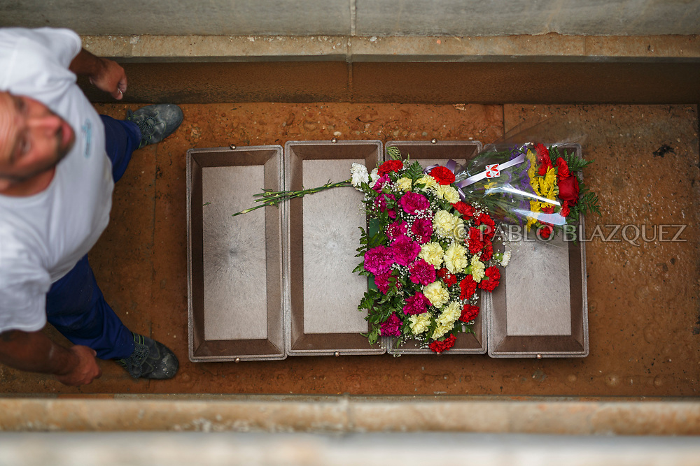 19/05/2018. Boxes containing the remains of Tomas and Manuel Escamilla Rebollo, Angel Vinas Diaz and Casto Mercado Molada who were assassinated by dictator Francisco Franco's forces are placed inside a niche at the cemetery on May 19, 2018 in Sacedon, Guadalajara province, Spain. General Franco's forces killed Timoteo Mendieta and other people between 1939 and 1940 after Spain's Civil War and buried them in mass graves in Guadalajara's cemetery. Argentinian judge Maria Servini used the international human rights law and ordered the exhumation and investigation of Mendieta's mass grave. The exhumation was carried out by Association for the Recovery of Historical Memory (ARMH) recovering 50 bodies from 2 mass graves and identified 24 of them. Spain's Civil War took the lives of thousands of people on both sides, but Franco continued his executions after the war has finished. Spanish governments has never done anything to help the victims of the Civil War and Franco's dictatorship while there are still thousands of people missing in mass graves around the country. (© Pablo Blazquez)