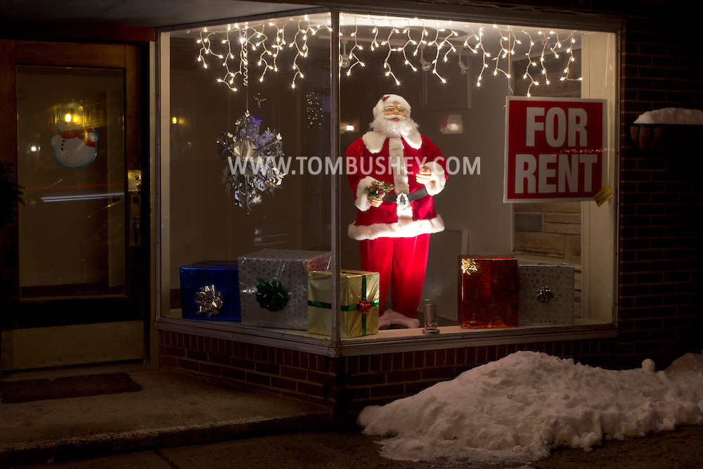 Wurtsboro, New York -  Santa in the window display of a store for rent on Sullivan Street on Jan. 1, 2013. ©Tom Bushey / The Image Works