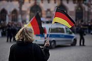 Frankfurt am Main | 30 Mar 2015<br /> <br /> Am Montag (30.03.2015) demonstrierten etwa 40 Menschen unter dem Namen &quot;Freie B&uuml;rger f&uuml;r Deutschland&quot; auf dem R&ouml;merberg in Frankfurt am Main gegen Islamisierung und zahlreiche andere &Uuml;bel, die Gruppe war zuvor unter dem Namen &quot;PEGIDA&quot; aufgetreten. Etwa 600 Menschen protestierten lautstark gegen diese Kundgebung.<br /> Hier: &quot;Freie B&uuml;rger f&uuml;r Deutschland&quot;-Demonstranten mit Deutschlandfahne.<br /> <br /> &copy;peter-juelich.com<br /> <br /> [No Model Release | No Property Release]