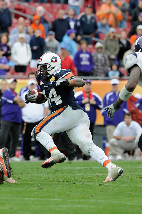 January 1, 2010: Ben Tate of the Auburn Tigers in action during the NCAA football game between the Northwestern Wildcats and the Auburn Tigers in the Outback Bowl. The Tigers defeated the Wildcats 38-35 in overtime.