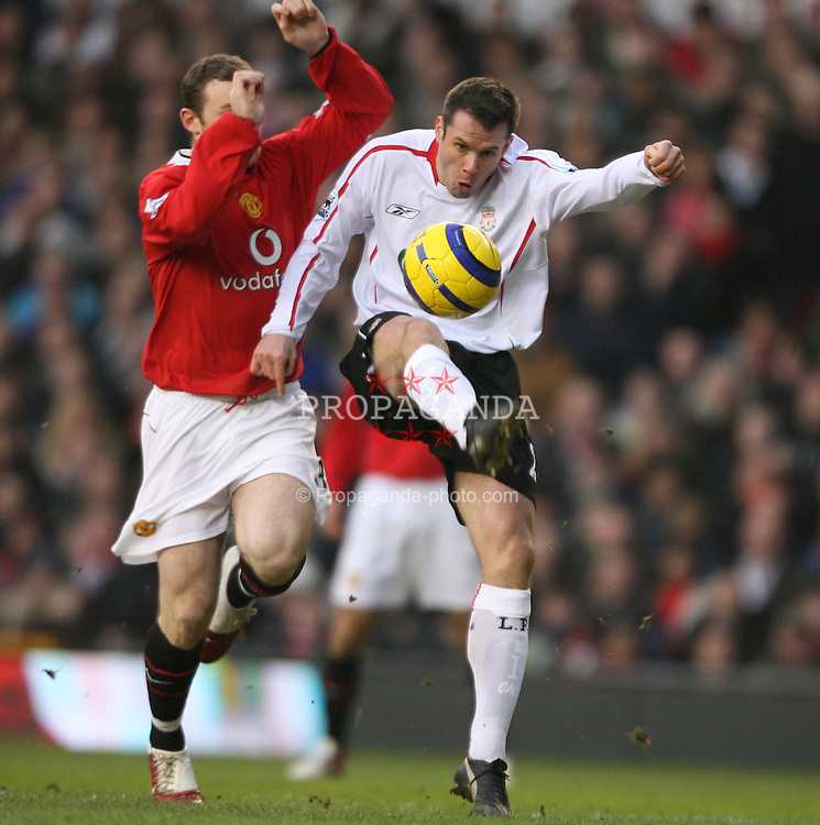 MANCHESTER, ENGLAND - SUNDAY, JANUARY 22nd, 2006: Liverpool's Jamie Carragher and Manchester United's Wayne Rooney during the Premiership match at Old Trafford. (Pic by David Rawcliffe/Propaganda)