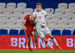 CARDIFF, WALES - Monday, September 9, 2019: Wales' Jonathan Williams is challenged by Belarus' Kiryl Piachenin during the International Friendly match between Wales and Belarus at the Cardiff City Stadium. (Pic by David Rawcliffe/Propaganda)