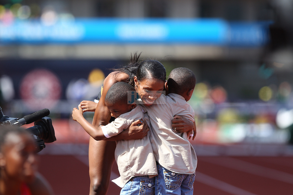 Lashinda Demus celebrates after winning the finals of the 400m hurdles during day 10 of the U.S. Olympic Trials for Track & Field at Hayward Field in Eugene, Oregon, USA 1 Jul 2012..(Jed Jacobsohn/for The New York Times)....