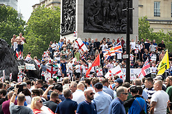 © Licensed to London News Pictures. 09/06/2018. London, UK. 1000s of supporters of EDL founder Tommy Robinson ( real name Stephen Yaxley-Lennon ) demonstrate in Trafalgar Square in Westminster after Robinson was convicted of Contempt of Court . Robinson was already serving a suspended sentence for Contempt of Court over a similar incident , when he was convicted on Friday 25th May 2018 . Photo credit: Joel Goodman/LNP
