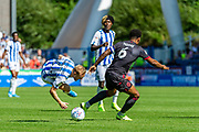 Reading captain challenge on Huddersfield Town Alex Pritchard during the EFL Sky Bet Championship match between Huddersfield Town and Reading at the John Smiths Stadium, Huddersfield, England on 24 August 2019.