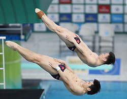 March 9, 2018 - Beijing, China - China's Cao Yuan (bottom), Xie Siyi compete during the  Men's 3m Synchronised final at the FINA Diving World Series 2018 in Beijing. China's Cao Yuan/Xie Siyi claimed the title with 497.34 points. (Credit Image: © Xu Zijian/Xinhua via ZUMA Wire)