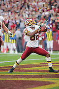 LANDOVER, MD - NOVEMBER 26:  Antwaan Randle El #82 of the Washington Redskins celebrates after scoring a third quarter touchdown on a four yard reception against the Carolina Panthers at FedExField on November 26, 2006 in Landover, Maryland. The Redskins defeated the Panthers 17-13. ©Paul Anthony Spinelli *** Local Caption *** Antwaan Randle El
