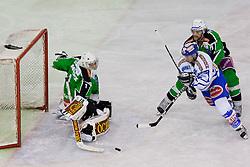 06.01.2012, Hala Tivoli, Ljubljana, SLO, EBEL, HDD Tilia Olimpija vs EC Rekord Fenster VSV, im Bild Marco Pewal (EC Rekord Fenster VSV, #36) vs Jean-Philippe Lamoureux (HDD Tilia Olimpija, #1) and Brad Cole (HDD Tilia Olimpija, #2) // during ice-hockey match between HDD Tilia Olimpija and EC Rekord Fenster VSV in 38th Round of EBEL league, on Januar 6, 2012 at Hala Tivoli, Ljubljana, Slovenia. EXPA Pictures © 2012, PhotoCredit: EXPA/ Sportida/ Matic Klansek Velej..***** ATTENTION - OUT OF SLO *****