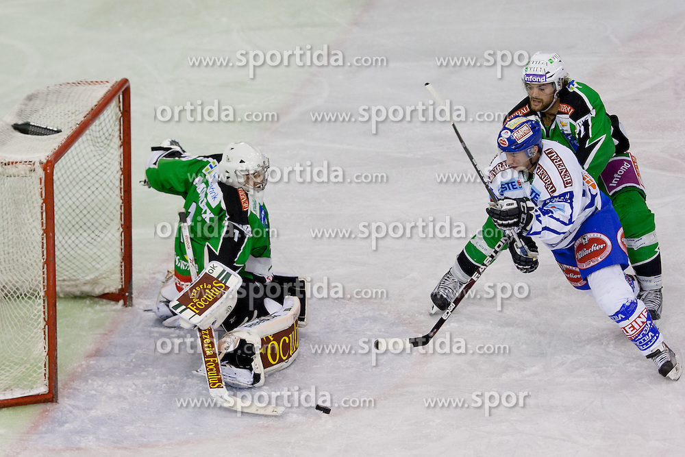 06.01.2012, Hala Tivoli, Ljubljana, SLO, EBEL, HDD Tilia Olimpija vs EC Rekord Fenster VSV, im Bild Marco Pewal (EC Rekord Fenster VSV, #36) vs Jean-Philippe Lamoureux (HDD Tilia Olimpija, #1) and Brad Cole (HDD Tilia Olimpija, #2) // during ice-hockey match between HDD Tilia Olimpija and EC Rekord Fenster VSV in 38th Round of EBEL league, on Januar 6, 2012 at Hala Tivoli, Ljubljana, Slovenia. EXPA Pictures © 2012, PhotoCredit: EXPA/ Sportida/ Matic Klansek Velej..***** ATTENTION - OUT OF SLO *****