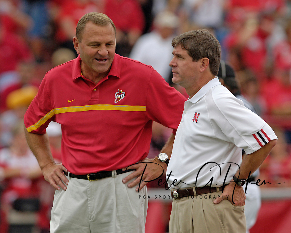Iowa State head coach Dan McCarney (L) and Nebraska head coach Bill Callahan meet before their teams face one another at Memorial Stadium in Lincoln, Nebraska, Oct. 1, 2005.
