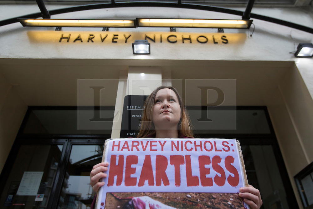 © licensed to London News Pictures. London, UK 21/09/2013. Anti-fur protesters demonstrating outside Harvey Nichols store in Knightsbridge as the department store chain has decided to drop it's fur free policy and start selling fur again after almost 10 years. Photo credit: Tolga Akmen/LNP