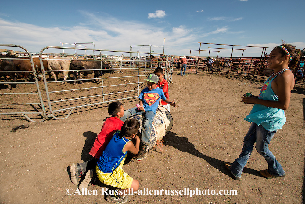 Crow Fair Rodeo, Crow Indian Reservation, Montana, kids playing bucking horse