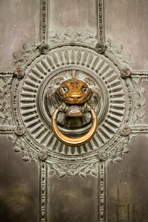 Lion head door pull on entry door of Sacre-Coeur church, Montmartre, Paris, France<br />