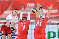 14.09.2014, Luczniczka Hall, Bydgoszcz, POL, FIVB WM, Polen vs Frankreich, 2. Runde, Gruppe E, im Bild Mariusz Wlazly, Kevin Tillie, Nicolas Le Goff // during the FIVB Volleyball Men's World Championships 2nd Round Pool F Match beween Poland and France at the Luczniczka Hall in Bydgoszcz, Poland on 2014/09/14. EXPA Pictures © 2014, PhotoCredit: EXPA/ Newspix/ Mariusz Palczynski<br /> <br /> *****ATTENTION - for AUT, SLO, CRO, SRB, BIH, MAZ, TUR, SUI, SWE only*****